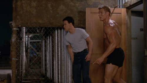 Screenshot where Lundgren has just come out a room, in his undies. Lee is fully dressed.