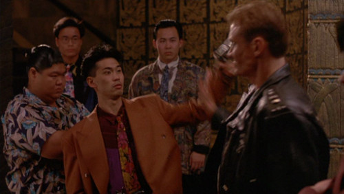 Screenshot of Lundgren confronting a group of gangsters who all look amazing.